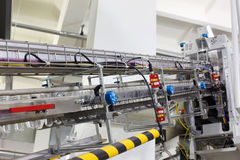 Conveyor with preforms for production of bottles Royalty Free Stock Photo