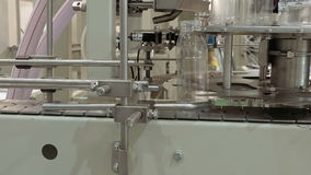 Conveyor product line for pouring beverage bottles stock footage