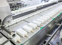 Conveyor production of stick ice-cream at factory Stock Photography