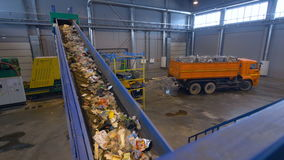 Conveyor at a recycling plant. No people. stock video footage