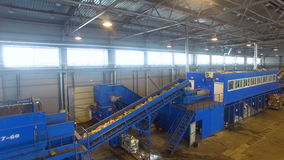 Conveyor at a recycling plant. Wide angle shot from drone. stock video footage