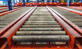 Conveyor rollers in distribution warehouse Royalty Free Stock Photography