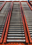 Conveyor rollers in distribution warehouse Stock Image