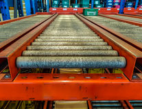 Conveyor rollers in distribution warehouse Stock Images