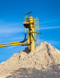Conveyor Sand Mine. Sand Hill at a Sand Mine with Blue Sky Royalty Free Stock Photography