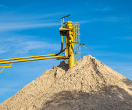 Conveyor at a Sand Mine. Mine Conveyor at a Sand Hill with Blue Sky Royalty Free Stock Images