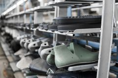 The conveyor on a shoes factory with shoe and sole. Mass production of footwear. royalty free stock image