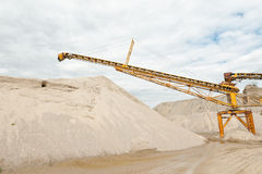 Conveyor on site at gravel pit. In front of blue sky with clouds Royalty Free Stock Image