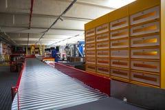 Conveyor sorting belt at distribution warehouse. Empty conveyor sorting belt at distribution warehouse. Distribution hub for sorting packages and parcels stock images
