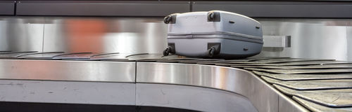 The conveyor suitcases Stock Images