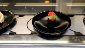 Conveyor sushi belt. Sushi tray on conveyor belt in restaurant stock video footage