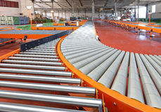 Conveyor System. Conveyor Roller Sorting System in Distribution Warehouse Stock Photos