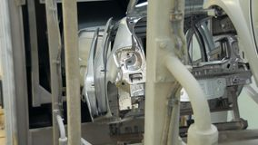 Conveyor tape with unfinished car bodies , moving to other department