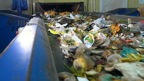 Conveyor transporting a large amount of trash. Conveyor transporting a large amount of trash at waste processing plant stock video footage