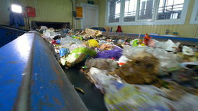 Conveyor transporting a large amount of waste. Conveyor transporting a large amount of trash at waste processing plant stock video