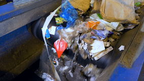 Conveyor transporting a large quantity of trash. Conveyor transporting a large amount of trash at waste processing plant stock video footage