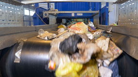 Conveyor transporting a large quantity of waste. Conveyor transporting a large amount of trash at waste processing plant stock footage