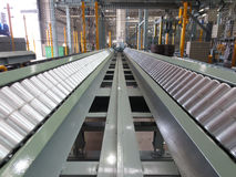 Conveyor for transporting the plant. Conveyor for transporting the plant in factory Royalty Free Stock Photography