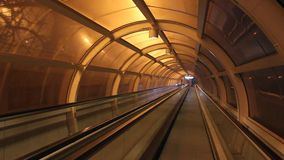 Conveyor tunnel. Walkway lit up at night stock video