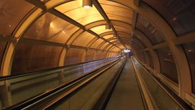 Conveyor tunnel. Walkway lit up at night stock footage