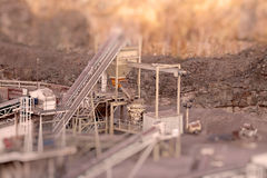 Conveyors at quarry tilt and shift A. Tilt and shift photograph of a machine with conveyors at a working quarry Royalty Free Stock Images