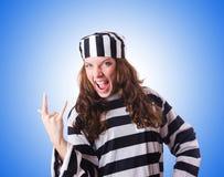 Convict criminal in striped uniform Stock Image