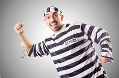 Convict criminal in striped uniform Stock Photos