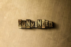 CONVINCED - close-up of grungy vintage typeset word on metal backdrop. Royalty free stock illustration.  Can be used for online banner ads and direct mail Stock Images