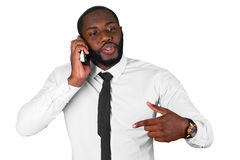Convincing talk on the phone. Afroamerican sales manager. Black man having business conversation. Confident leader on the phone Royalty Free Stock Photos