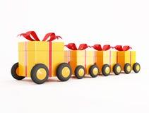 Convoglio arancione del contenitore di regalo sulle rotelle Fotografia Stock Libera da Diritti