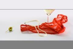 Convoitise et perles de lacet Photographie stock