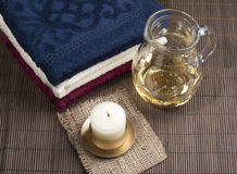 Convolute towels and candle Stock Photography