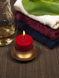 Convolute towels and candle Stock Photos