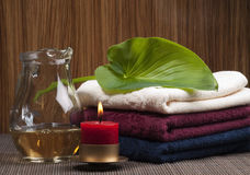 Convolute towels and candle. Convolute towels and conflagrant candle Royalty Free Stock Images