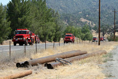 Convoy of fire engines heads to fire area Stock Images