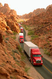 Convoy of semi-trucks Royalty Free Stock Images