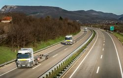 Semi Trucks without trailers in highway Traffic. Convoy of Semi Trucks without trailers in country highway Traffic Royalty Free Stock Photos