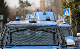 Convoy with several police cars and armored vehicles on patrol t Royalty Free Stock Photography