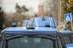 Convoy with several police cars and armored vehicles on patrol t Stock Photography