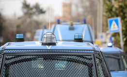 Convoy with several police cars and armored vehicles on patrol t Stock Image