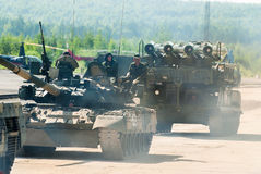 Convoy of T80U tank and Buk-M1-2 in motion. Russia Royalty Free Stock Photo