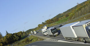 Convoy of trucks on highway Stock Images