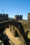 Conway Castle. Scenic view of interior of Conway castle with turrets and blue sky background, Wales, United Kingdom Royalty Free Stock Image