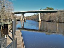 Conway Riverwalk in South Carolina. The Conway Riverwalk is a serene wooden path that winds along the blackwater of the Waccamaw River in South Carolina royalty free stock photos