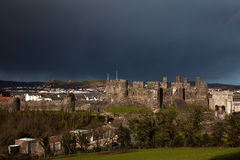 Conwy Castle and dark skies Stock Photos