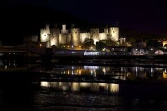 Conwy castle at night, lights and water reflections on Conwy key Stock Image