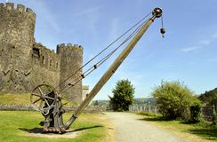 Conwy castle old lifting equipment. Old lifting equipment used during the Industrial revolution outside Conwy castle Royalty Free Stock Photography