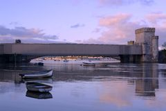 Conwy. North wales, castle bridge, with boats in the harbour at sunset Stock Photo