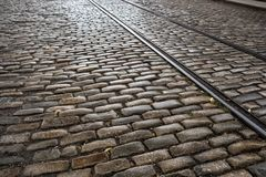 Cooble stone strret with old train tracks stock photos