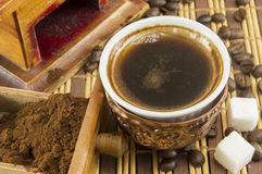 Cooffee time. Cup of coffee with sugar and coffee beans Royalty Free Stock Photo